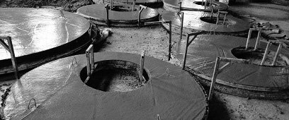 Железобетонная плита перекрытия колодезного кольца ПП 15